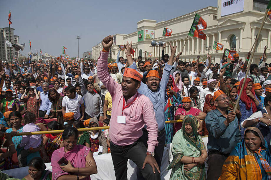 India's opposition Bharatiya Janata Party (BJP) supporters shout slogans during their prime ministerial candidate Narendra Modi's election rally in Vaishali, outskirts of New Delhi, India, Thursday, April, 3, 2014. India will hold national elections from April 7 to May 12, kicking off a vote that many observers see as the most important election in more than 30 years in the world's largest democracy. (AP Photo/Tsering Topgyal)