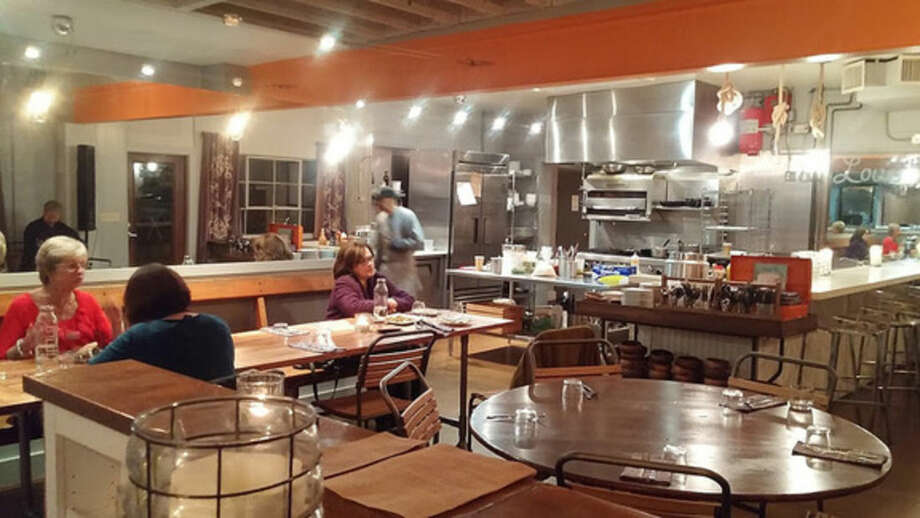 Photo by Frank WhitmanIndustrian chic dining by the open kitchen at Sugar and Olives in Norwalk.