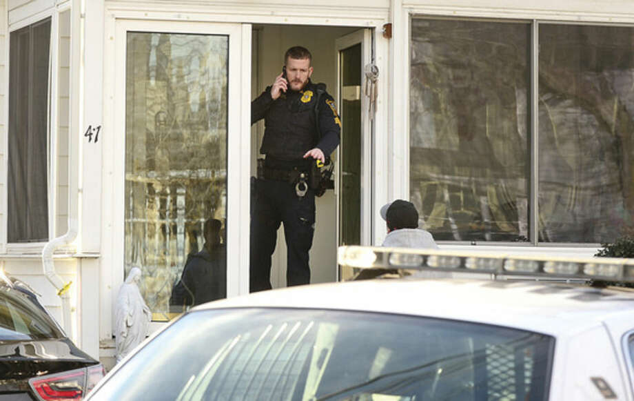 Hour photo / Erik Trautmann Norwalk police investigate an altercation at 41 Wilton Ave. Tuesday afternoon.