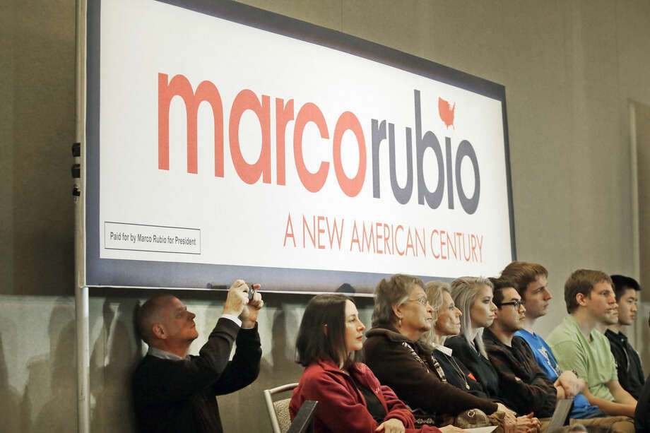 """In this Jan. 6, 2016, photo, supporters of Republican presidential candidate Sen. Marco Rubio listen to him speak at a rally in Dallas. The expectations game for """"establishment"""" candidates has added intrigue to the final sprint to Iowa's lead-off caucuses. While the fight for first place has settled into a two-way race between conservative favorites Ted Cruz and Donald Trump, some of the biggest unknowns surround the candidates for whom a loss in Iowa could still be viewed as a win. (AP Photo/LM Otero, File)"""
