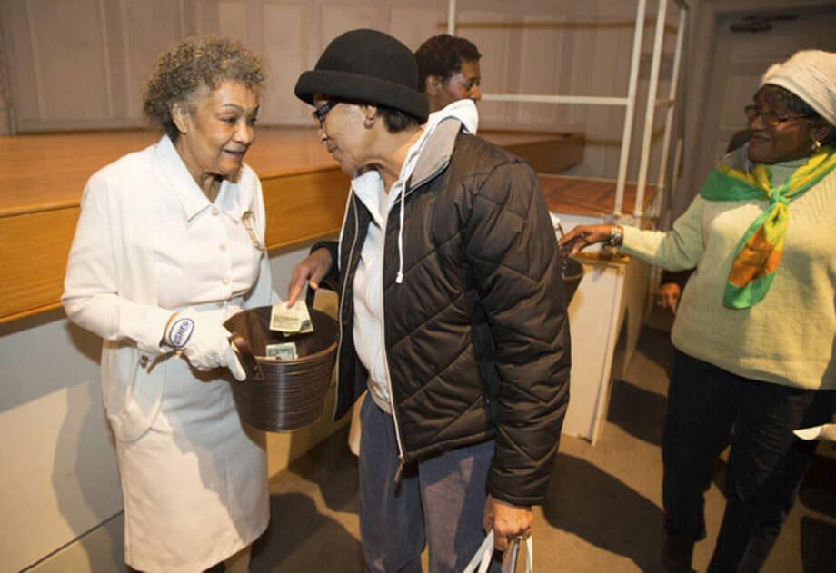 Hour photo/Chris Palermo. A patron has a word with Jean Carter, Fairfield County Calvary Baptist Church usher at the city-wide memorial observance of the national holiday honoring Rev. Dr. Martin Luther King, Jr. Monday night at Norwalk City Hall.