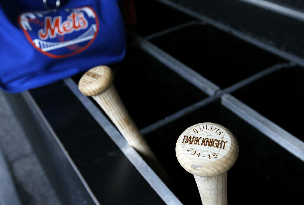 """The bats of New York Mets starting pitcher Matt Harvey are labeled """"dark knight,"""" in the dugout before a baseball game against the Washington Nationals at Nationals Park, Thursday, April 9, 2015, in Washington. Harvey will pitch in a major league game for the first time since August 2013, returning from Tommy John surgery. (AP Photo/Alex Brandon)"""