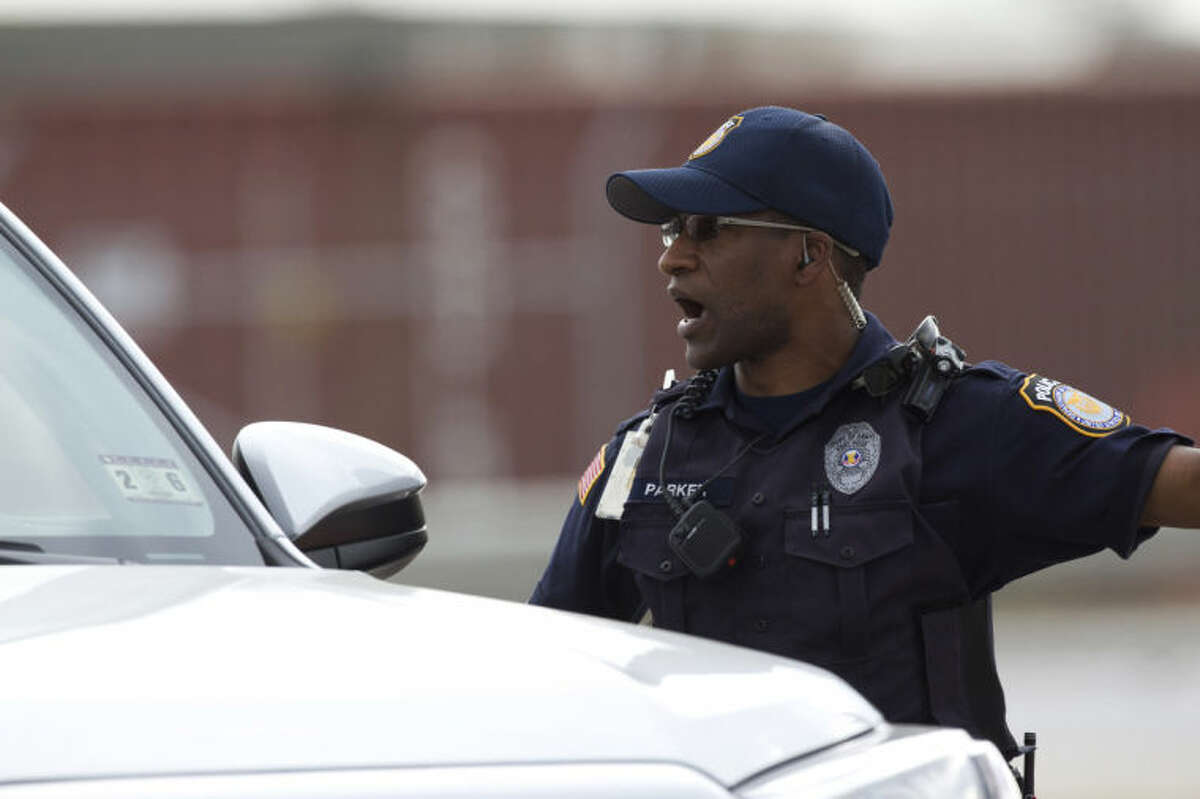 A Fort Hood Police Officer stops a vehicle near the main gate, Wednesday, April 2, 2014, as the military base was placed on lock down in Fort Hood, Texas. One person was killed and 14 injured in the shooting, and officials at Fort Hood said the shooter is believed to be dead. The details about the number of people hurt came from two U.S. officials who spoke on condition of anonymity because they were not authorized to discuss the information by name. (AP Photo/The Temple Daily Telegram, Rusty Schramm)