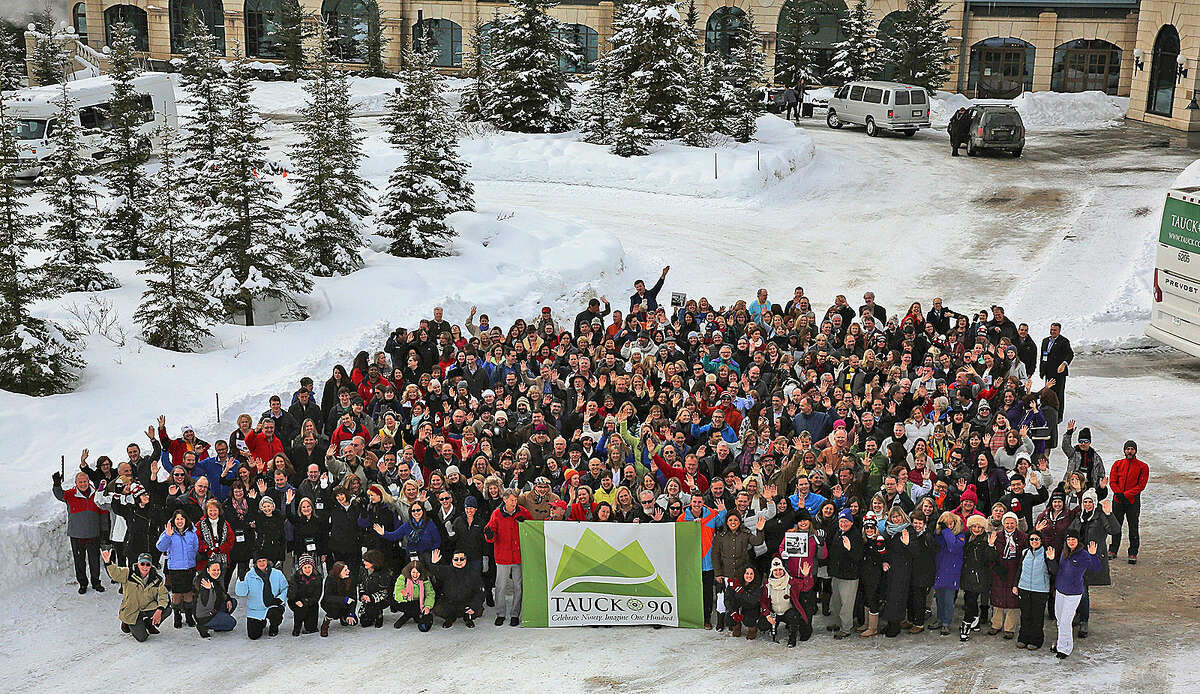 Contributed photo Tauck employees at a trip to Chateau Lake Louise in Alberta to celebrate 90 years in business.