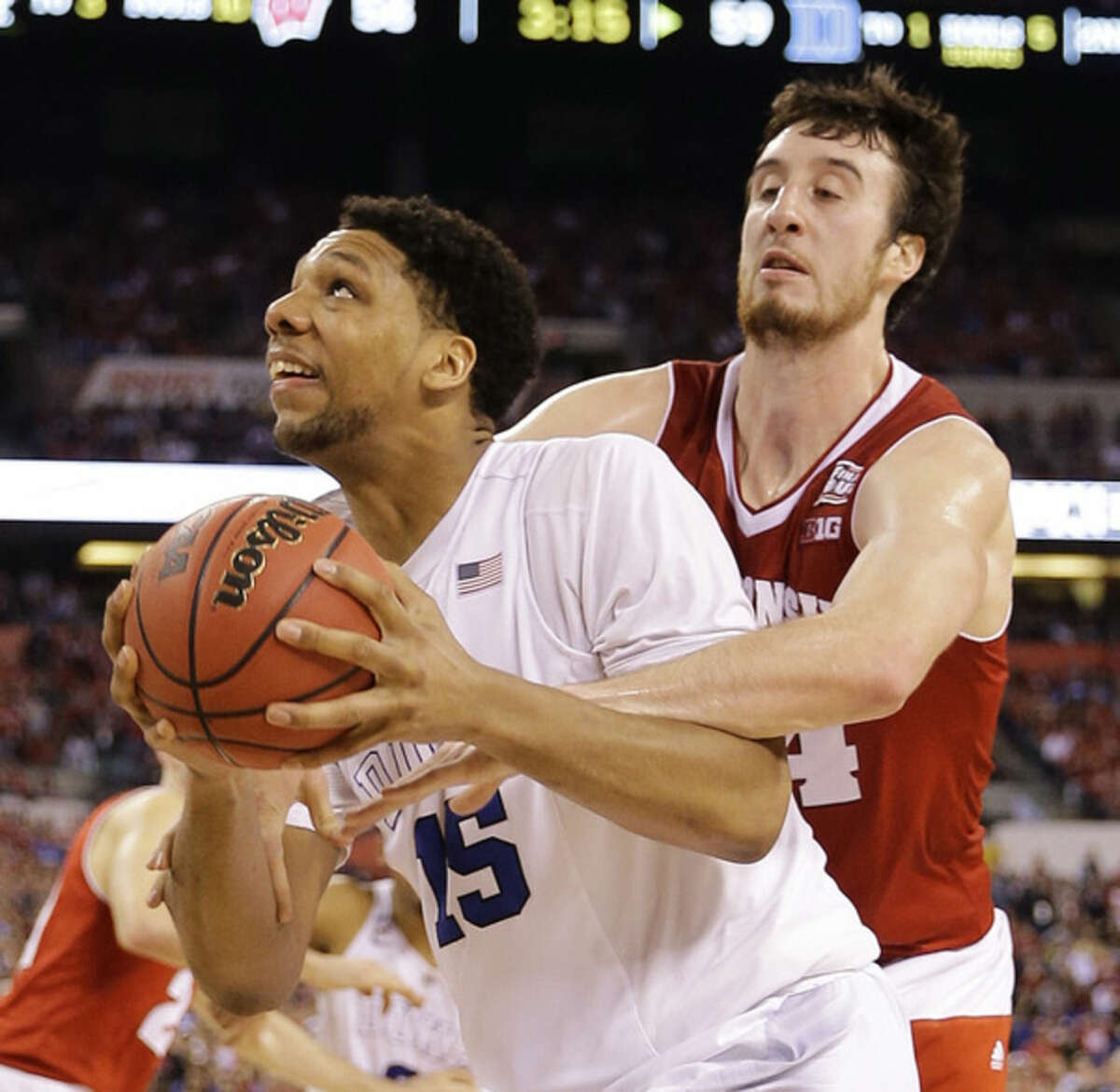 Duke's Jahlil Okafor (15) is fouled by Wisconsin's Frank Kaminsky (44) during the second half of the NCAA Final Four college basketball tournament championship game Monday, April 6, 2015, in Indianapolis. (AP Photo/David J. Phillip)