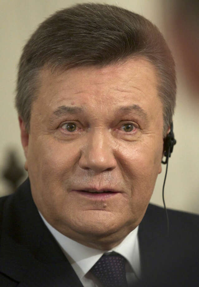 Ousted Ukrainian President Viktor Yanukovych speaks during an interview with The Associated Press, in Rostov-on-Don, Russia, Wednesday, April 2, 2014. Yanukovych says the annexation of Crimea was a tragedy and he would have done everything possible to prevent it, had he remained in power. (AP Photo/Ivan Sekretarev)