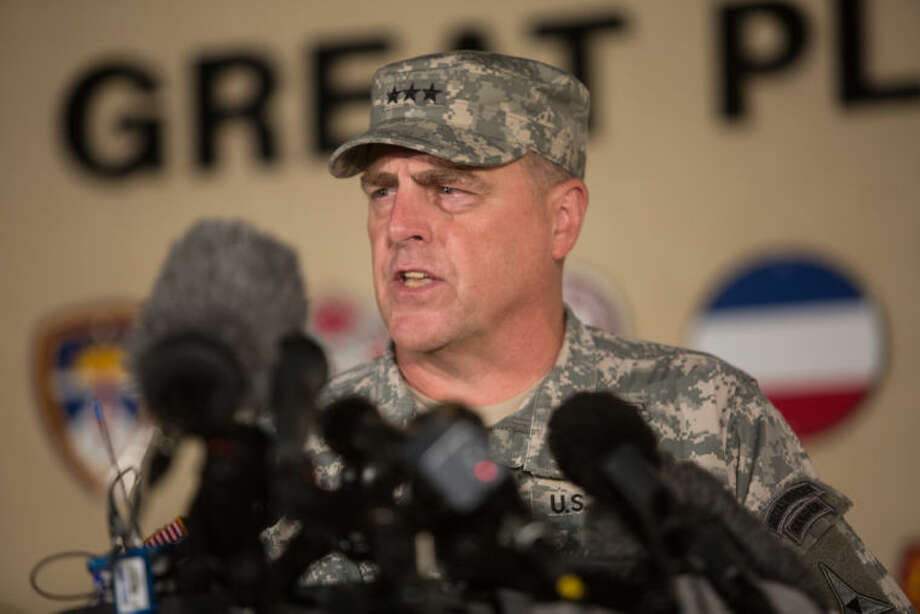 Lt. Gen. Mark Milley, the senior officer on base, speaks with the media outside of an entrance to the Fort Hood military base following a shooting that occurred inside, Wednesday, April 2, 2014, in Fort Hood, Texas. Four people were killed, including the gunman, and 16 were wounded in the attack, authorities said. (AP Photo/Tamir Kalifa)