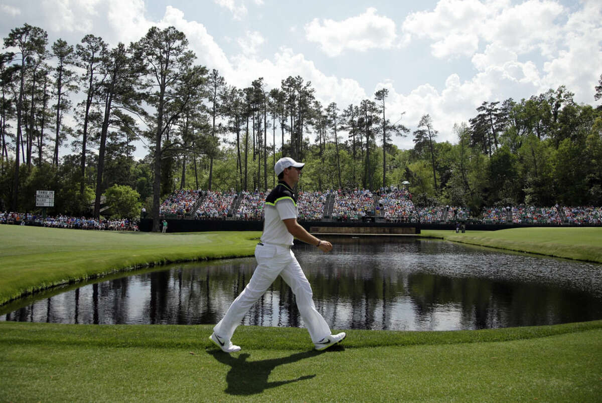 Rory McIlroy, of Northern Ireland, walks on the 15th fairway during the first round of the Masters golf tournament Thursday, April 9, 2015, in Augusta, Ga. (AP Photo/Matt Slocum)