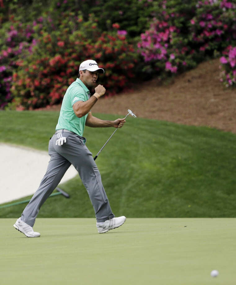 Jason Day, of Australia, reacts after missing an eagle putt on the 13th hole during the first round of the Masters golf tournament Thursday, April 9, 2015, in Augusta, Ga. (AP Photo/David J. Phillip)