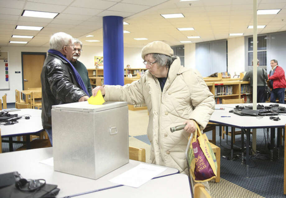 Hazel Lepotsky votes for the District A Democrats competing for 11 seats on the Norwalk Democratic Town Committee during caucus Wednesday at Kendall School.Hour Photo / Danielle Calloway