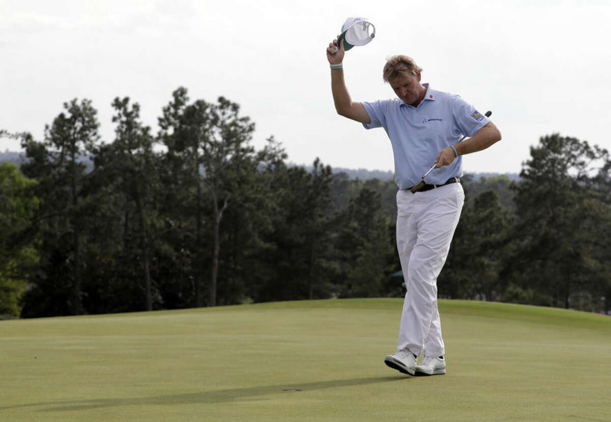 Ernie Els, of South Africa, tips his cap on the 18th green after his first round of the Masters golf tournament Thursday, April 9, 2015, in Augusta, Ga. (AP Photo/Chris Carlson)