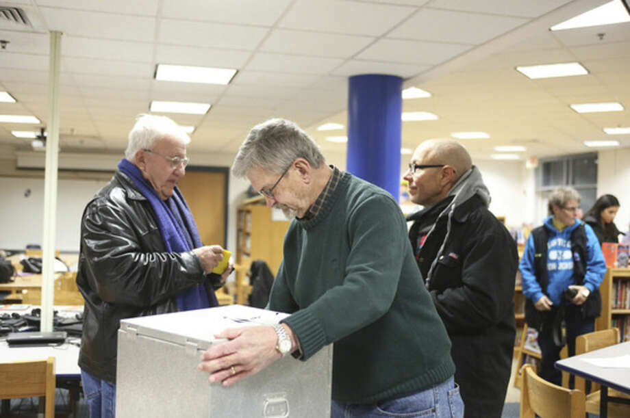Tod Bryant adjusts the ballot box for the District A Democrats competing for 11 seats on the Norwalk Democratic Town Committee during caucus Wednesday at Kendall School.Hour Photo / Danielle Calloway