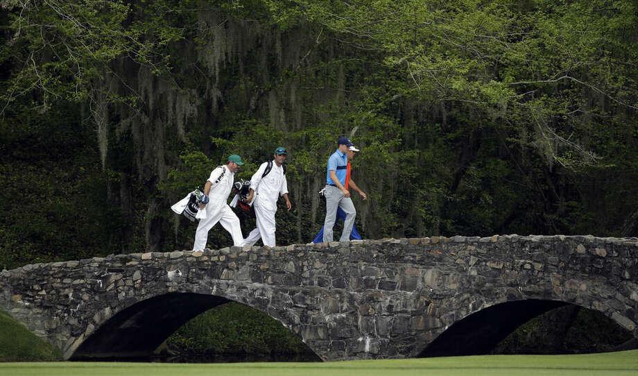 Jordan Spieth, left, walks across the Nelson Bridge with Billy Horschel during the first round of the Masters golf tournament Thursday, April 9, 2015, in Augusta, Ga. (AP Photo/Matt Slocum)