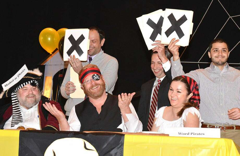 "Hour Photo/Alex von Kleydorff Team 'Word Pirates' Doug Hempstead, Dave McCarthy and Shannon O'Toole Giandurco get a word wrong but continue in the first round against The ""Rock Gods of Spelling"" of the 3rd Annual Community Spelling Bee, a fundraiser to support the programs of The Norwalk Education Foundation"