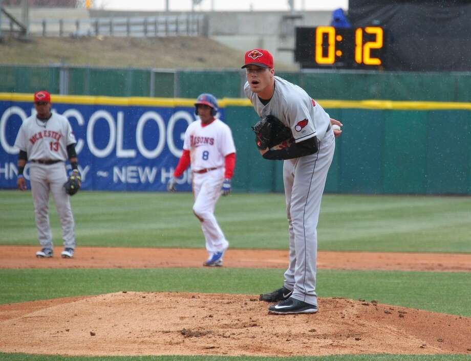 Rochester Red Wings pitcher Alex Meyer (32) looks in for a signal as a 20-second pitch clock is used for the Triple-A baseball opener between the Buffalo Bisons and Red Wings in Buffalo, N.Y., Thursday, April 9, 2015. (AP Photo/Bill Wippert)