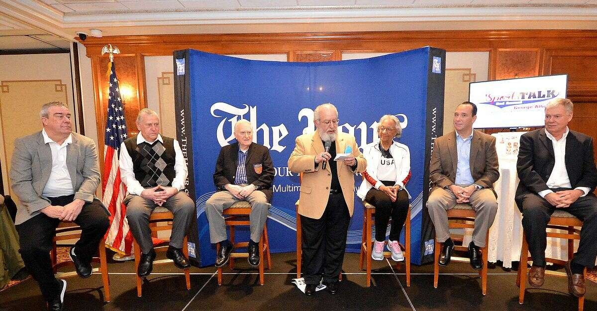 Hour Photo/Alex von Kleydorff The Hour Associate Editor and Host George Albano talks with panelists during The Hour's 2nd Annual Sports Talk at The Norwalk Inn and Conference Center on Thursday night