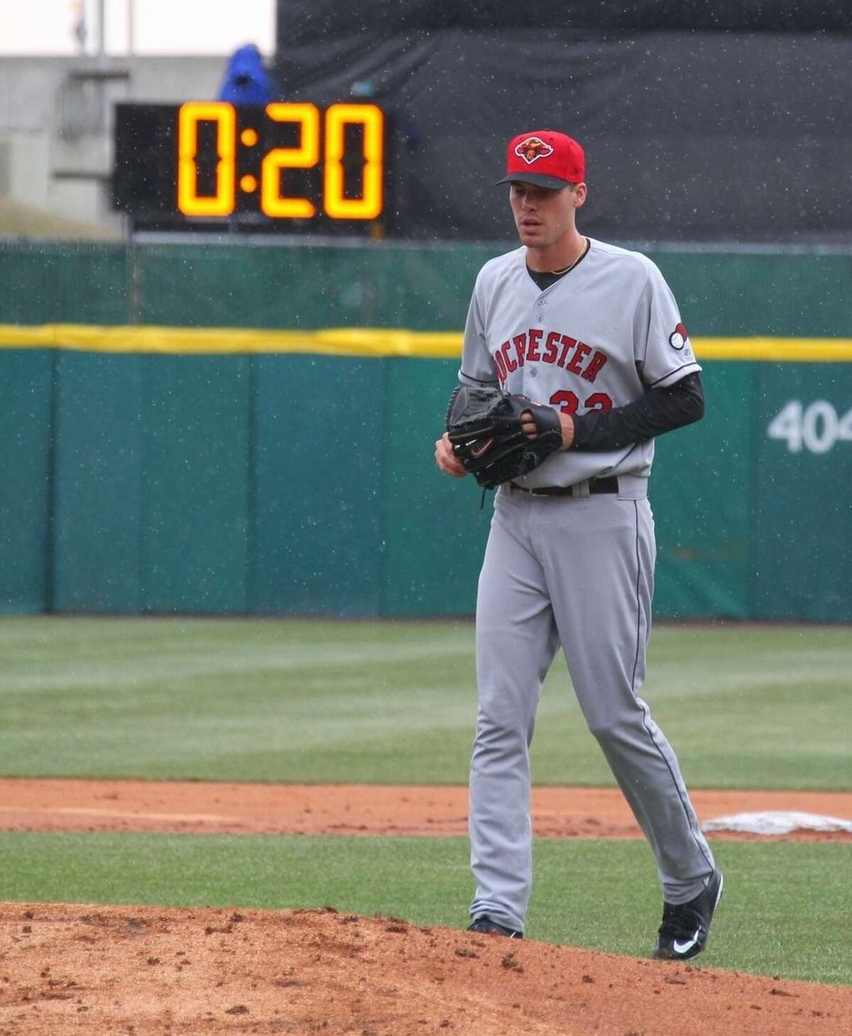 Rochester Red Wings pitcher Alex Meyer (32) walks to the mound as a 20-second pitch clock is used for the Triple-A baseball opener between the Buffalo Bisons and Red Wings in Buffalo, N.Y., Thursday, April 9, 2015. (AP Photo/Bill Wippert)