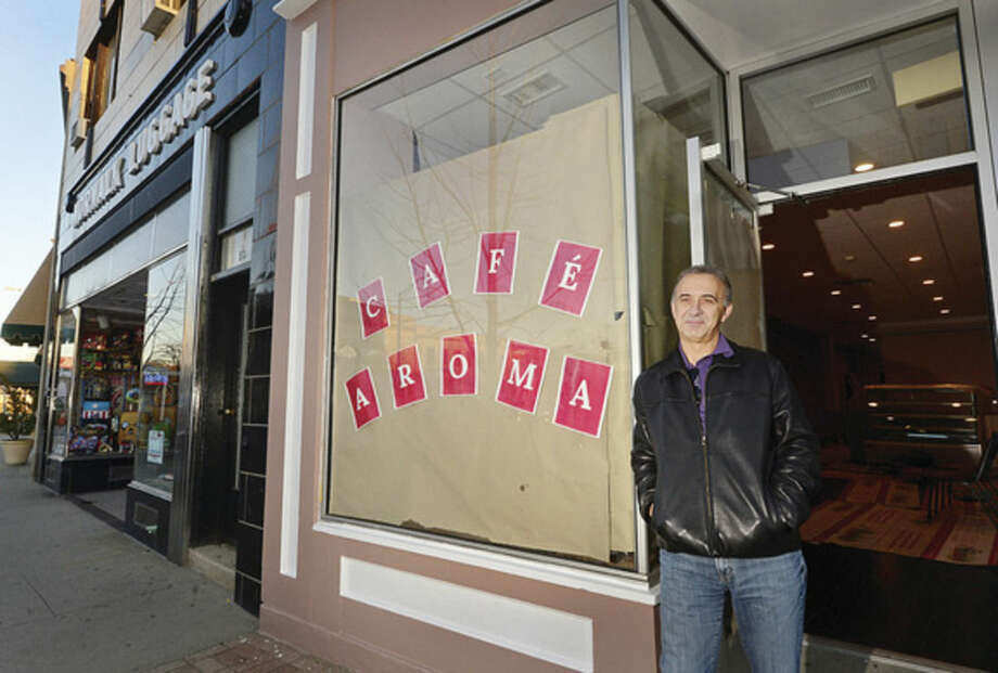 Hour photo / Erik TrautmannPaul Theodoridis will be opening a new coffee shop on Wall Street, Cafe Aroma.