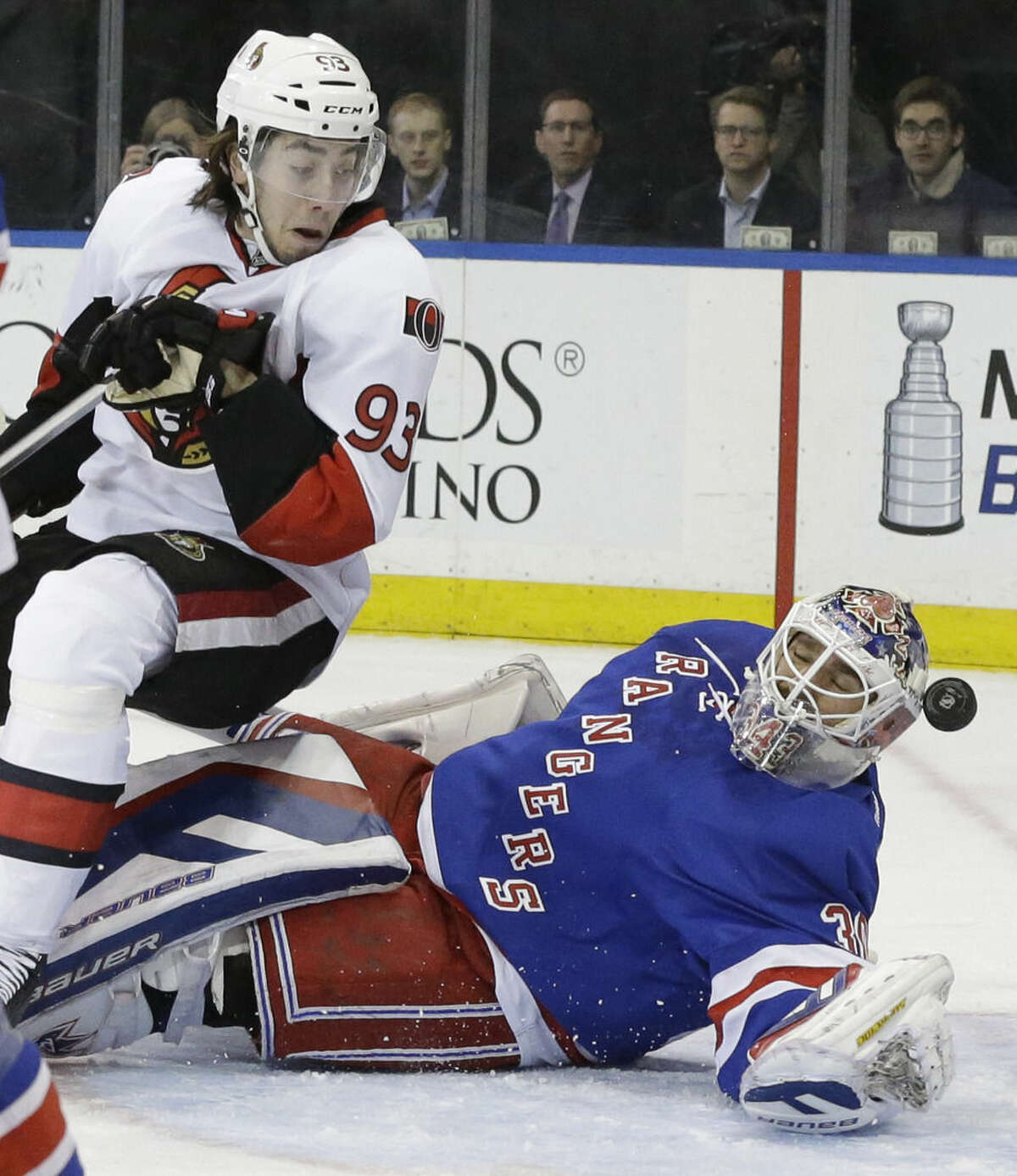 Ottawa Senators center Mika Zibanejad (93) watches as the puck gets past New York Rangers goalie Henrik Lundqvist during the first period of an NHL hockey game, Thursday, April 9, 2015, at Madison Square Garden in New York. The goal was disallowed. (AP Photo/Mary Altaffer)