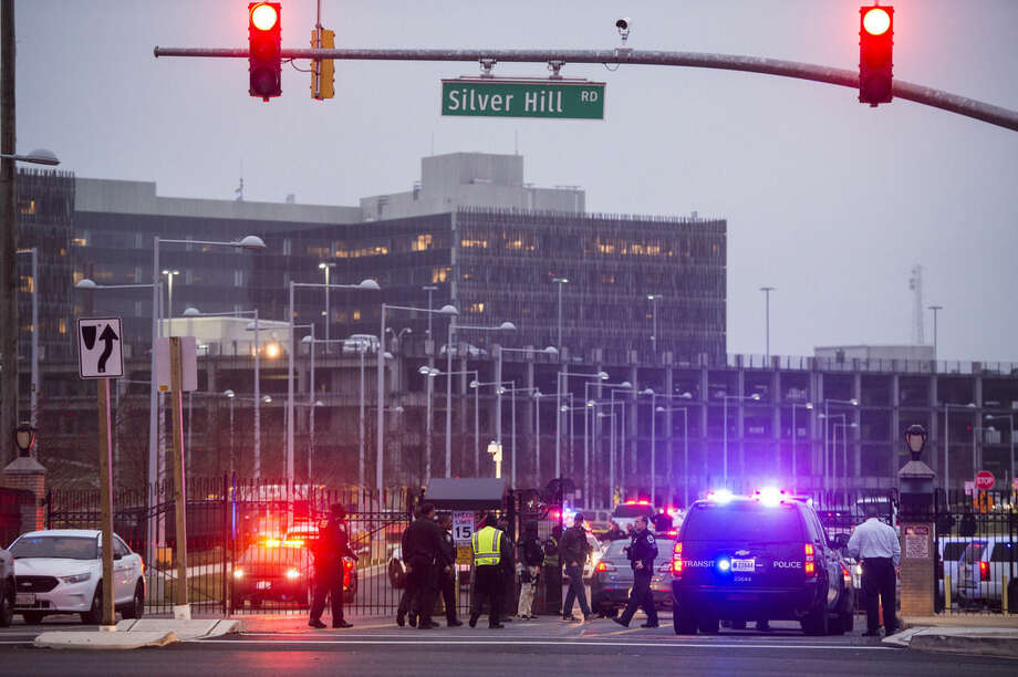 Officers prepare to head toward the U.S. Census Bureau building after reports that a federal officer had been shot at the U.S. Census Bureau in Silver Hill, MD on Friday, April 9, 2015. (AP Photo/The Washington Post, Jabin Botsford)