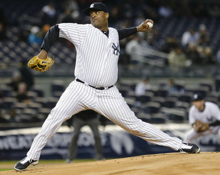 New York Yankees' CC Sabathia delivers a pitch during the first inning of a baseball game against the Toronto Blue Jays on Thursday, April 9, 2015, in New York. (AP Photo/Frank Franklin II)