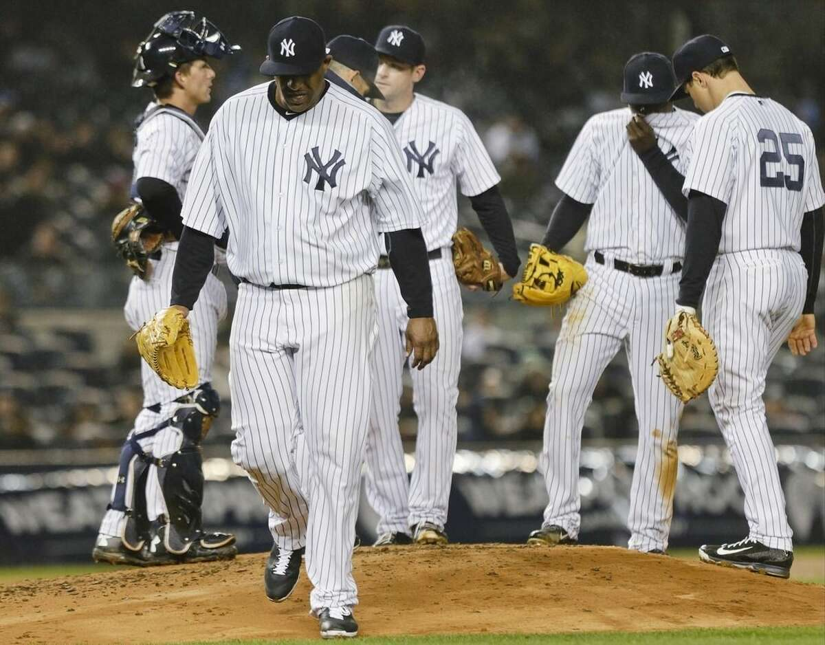 New York Yankees starting pitcher CC Sabathia leaves the baseball game against the Toronto Blue Jays during the sixth inning Thursday, April 9, 2015, in New York. (AP Photo/Frank Franklin II)