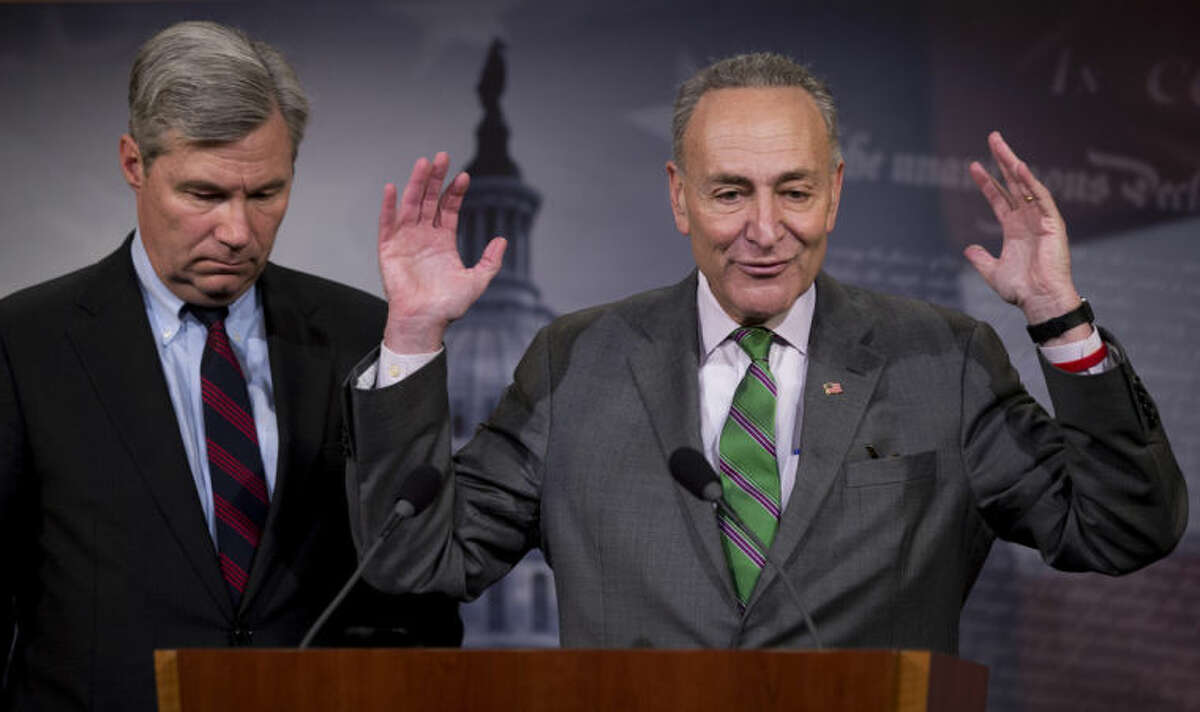 Sen. Charles Schumer, D-N.Y., right, accompanied by Sen. Sheldon Whitehouse, D-R.I., speak to reporters on Capitol Hill in Washington, Wednesday, April 2, 2014, about the Supreme Court¹s decision in the McCutcheon vs. FEC case, in which the Court struck down limits in federal law on the aggregate campaign contributions individual donors may make to candidates, political parties, and political action committees. (AP Photo/Manuel Balce Ceneta)