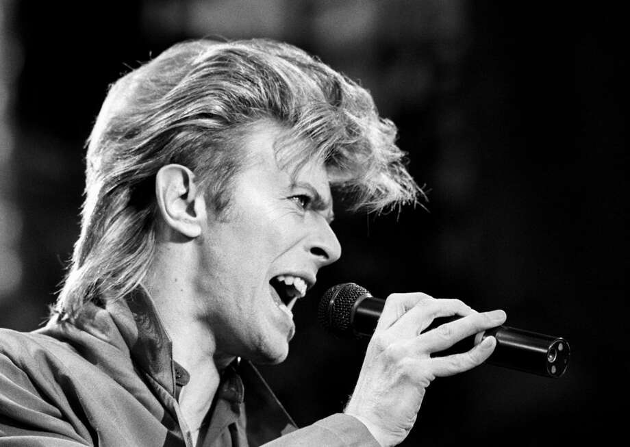 FILE - This is a June 19, 1987 file photo of David Bowie. Bowie, the other-worldly musician who broke pop and rock boundaries with his creative musicianship, nonconformity, striking visuals and a genre-bending persona he christened Ziggy Stardust, died of cancer Sunday Jan. 10, 2016. He was 69 and had just released a new album. (PA, File via AP) UNITED KINGDOM OUT NO SALES NO ARCHIVE