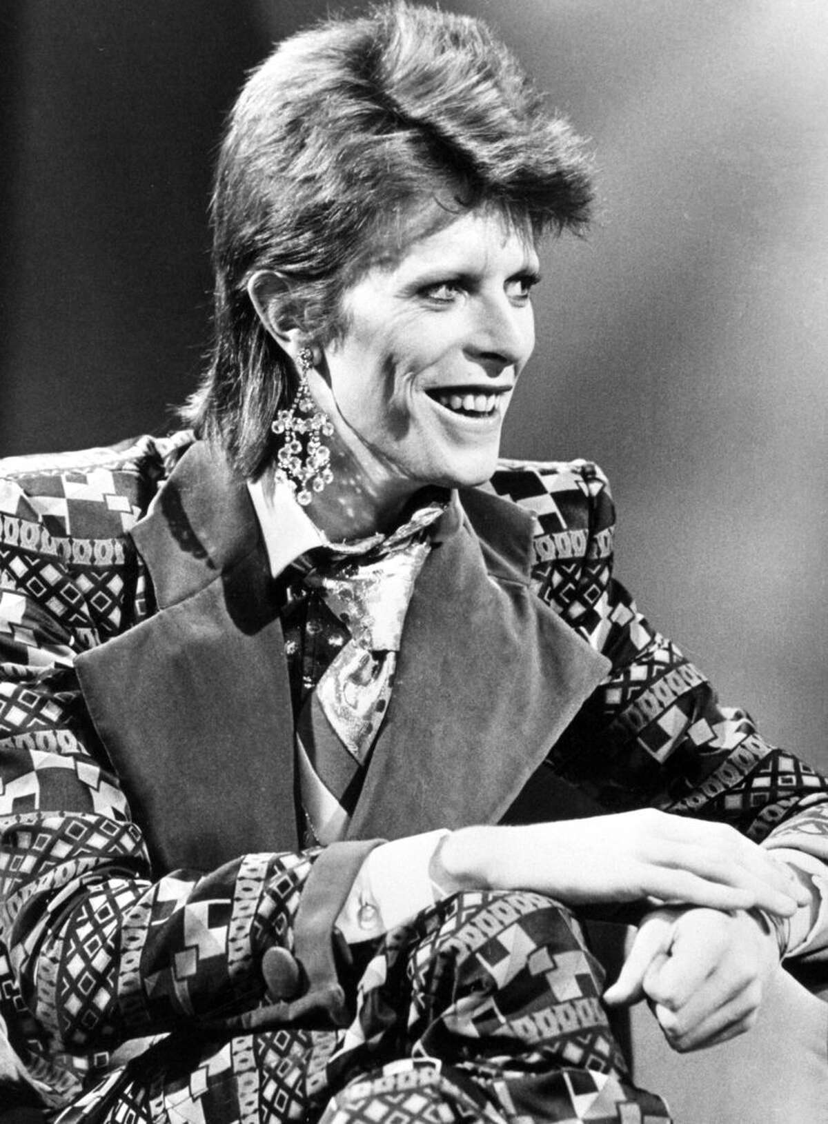 FILE - This is a Jan. 1, 1974 file photo of David Bowie. Bowie, the other-worldly musician who broke pop and rock boundaries with his creative musicianship, nonconformity, striking visuals and a genre-bending persona he christened Ziggy Stardust, died of cancer Sunday Jan. 10, 2016. He was 69 and had just released a new album. (PA, File via AP) UNITED KINGDOM OUT NO SALES NO ARCHIVE