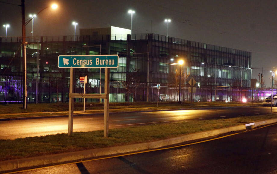 A sign for the U.S. Census Bureau headquarters campus as police search for an armed man who, according to a fire official, shot a security guard at a gate to the facility in Suitland, Md., Thursday, April 9, 2015. (AP Photo/Alex Brandon)