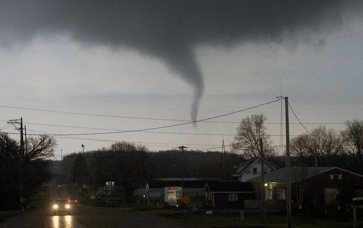 A funnel cloud crosses south Perryville Road on Thursday, April 9, 2015, south of Interstate 39 in Rockford, Ill. (AP Photo/Rockford Register Star, Max Gersh) MANDATORY CREDIT
