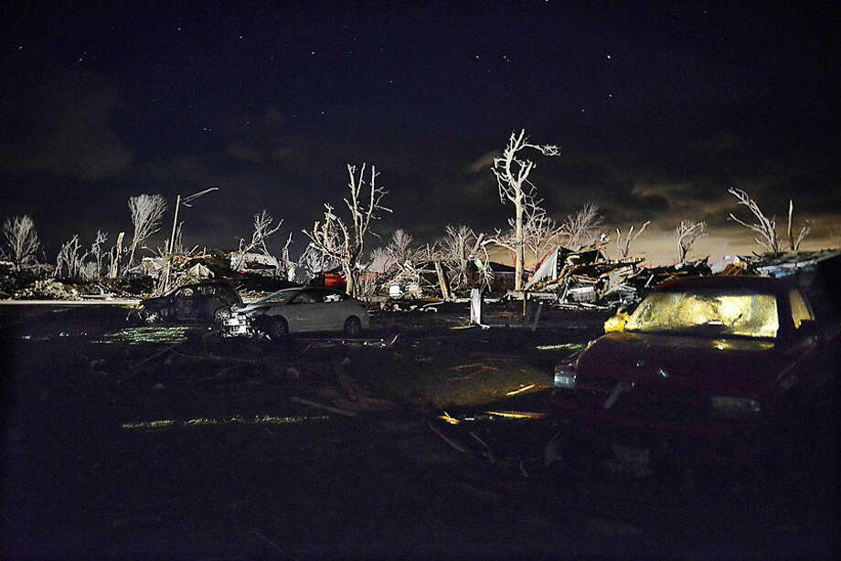 Damage after a tornado struck the small town of Fairdale Ill. the night of Thursday, April 9, 2015. Supercell thunderstorms produced a large tornado that touched down Thursday night in northern Illinois, killing at least one person and injuring at least seven others in one tiny community as severe weather pummeled the Midwest. Every home in the town was affected, authorities said. DeKalb County Sheriff Roger Scott said in a news release that approximately 15 to 20 were totally destroyed. (AP Photo/Daily Herald, John Starks)