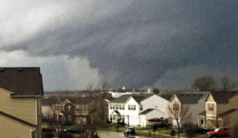 In this photo provided by Emily Mains, a tornado is viewed near Pearl Street from a home in the Kennedy's subdivision in Kirkland, Ill., on Thursday, April 9, 2015. One person was killed in the tiny community of Fairdale, James Joseph with the Illinois Department of Emergency Management said. (AP Photo/Emily Mains)