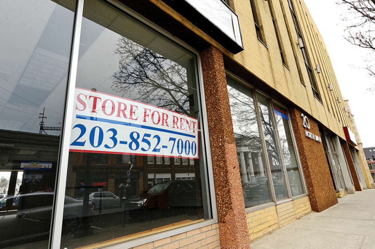 Hour photo / Erik Trautmann Reatil space at 20 North Main St. in SoNo still reamains unoccupied. Some businesses are finding hard to keep their doors open while others look to reinvent themselves.