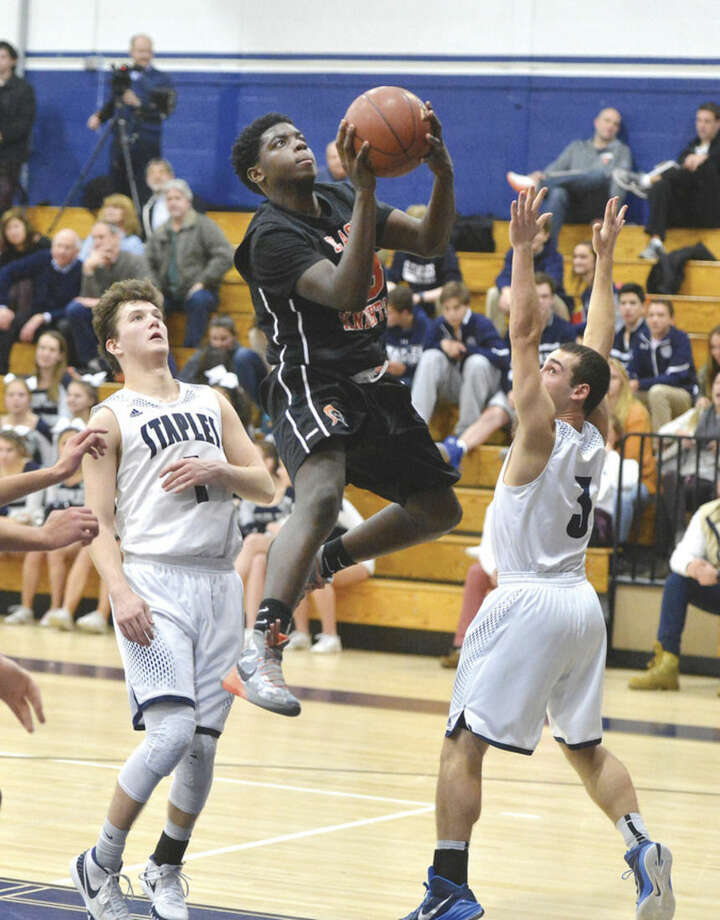 Hour Photo/Alex von Kleydorff Stamfords #23 Tevin St. John shoots vs Staples