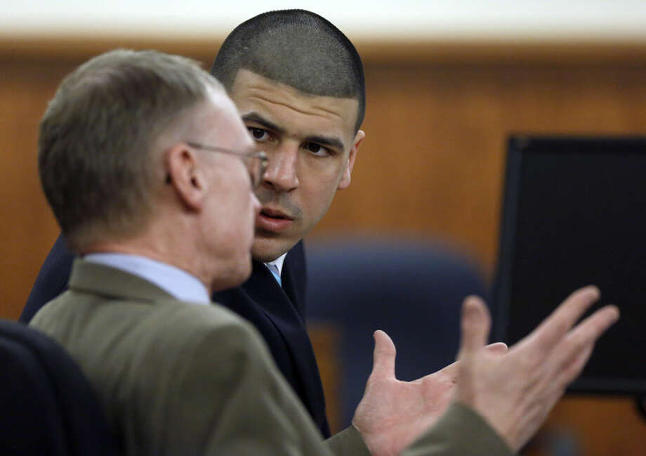 Former New England Patriots football player Aaron Hernandez, right, sits with defense attorney Charles Rankin, left, as the judge and attorneys for both sides discuss questions about evidence from the jury deliberating Hernandez's fate, during his murder trial Thursday, April 9, 2015, in Fall River, Mass. Hernandez is charged with killing Odin Lloyd. (AP Photo/Steven Senne, Pool)