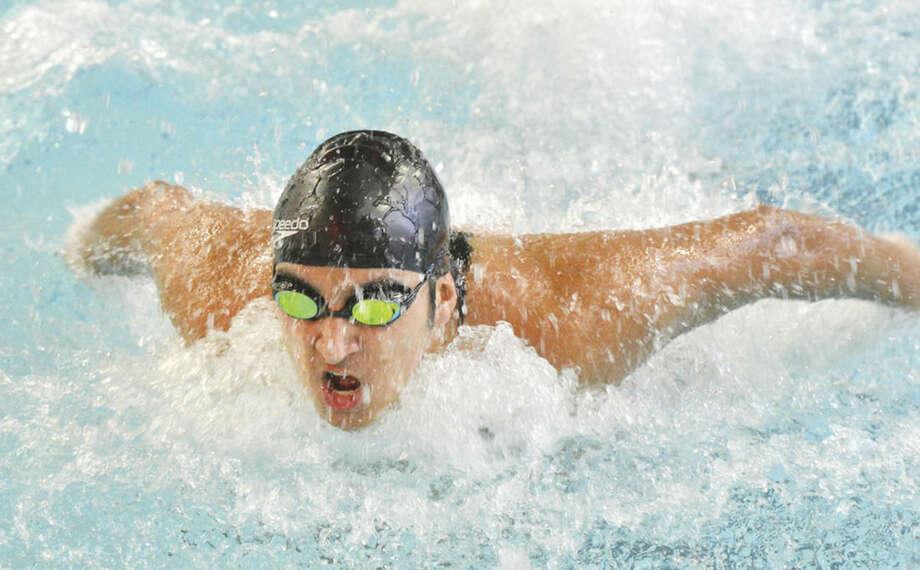 Hour Photo/Alex von KleydorffNicholas Roldan swims the 200 medley relay against the Fairfield co-op at Friday's FCIAC dual meet at the Pat Spinola Natatorium. Norwalk-McMahon won the meet 100-83.