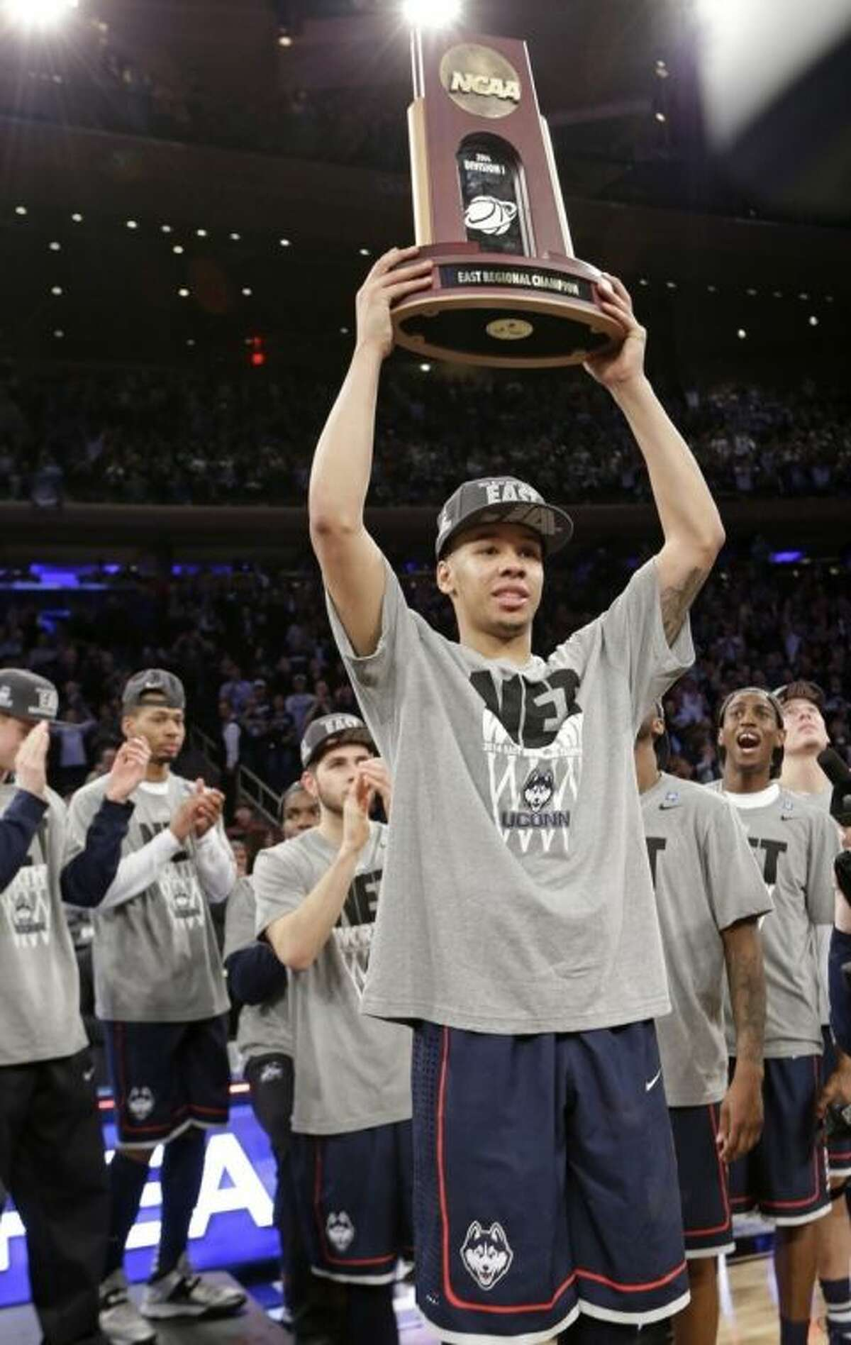 Connecticut's Shabazz Napier holds the championship trophy after a regional final against Michigan State in the NCAA college basketball tournament Sunday, March 30, 2014, in New York. Connecticut won the game 60-54. (AP Photo/Frank Franklin II)
