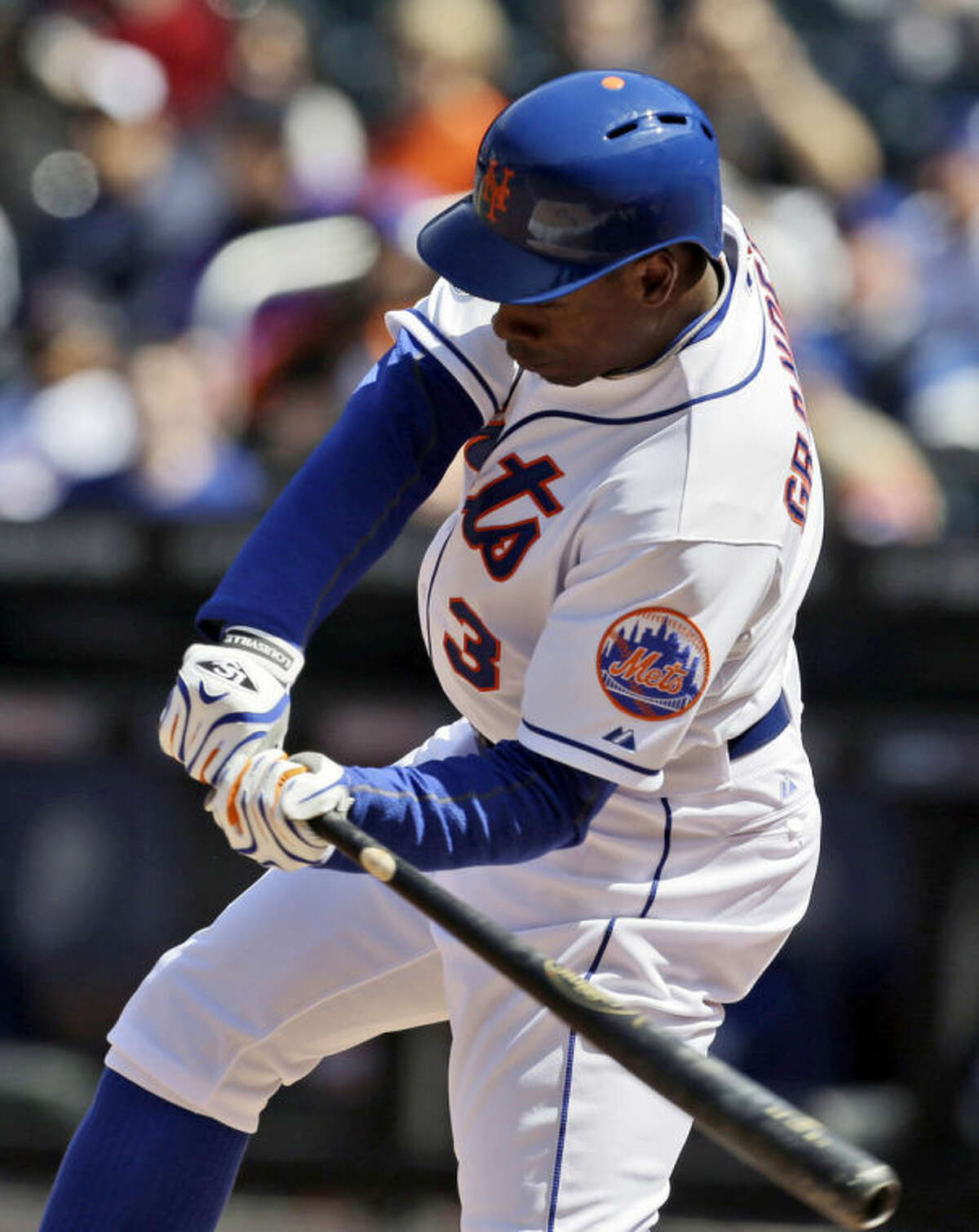 New York Mets' Curtis Granderson hits an RBI double during the first inning of the baseball game against the Washington Nationals at Citi Field, Thursday, April 3, 2014 in New York. (AP Photo/Seth Wenig)