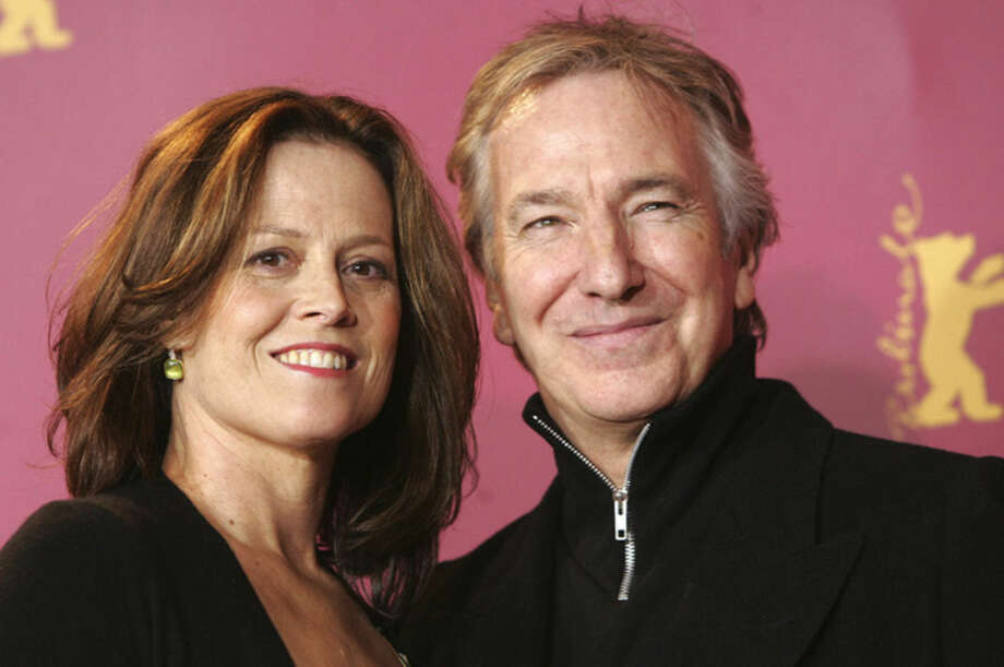 "File - In this Feb. 9, 2006 file photo, US actress Sigourney Weaver, left, and British actor Alan Rickman pose during a photocall for their movie 'Snow Cake' at the Berlinale in Berlin. British actor Alan Rickman, whose career ranged from Britain's Royal Shakespeare Company to the ""Harry Potter"" films, has died. He was 69. Rickman's family said Thursday, Jan. 14, 2016 that the actor had died after a battle with cancer. (AP Photo/Hermann J. Knippertz, File)"