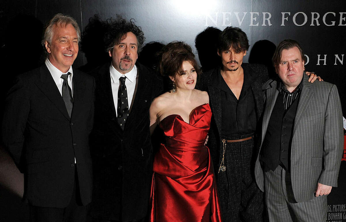 FILE - In this Jan. 10, 2008 file photo, from left to right, British actor Alan Rickman, British director Tim Burton, British actress Helena Bonham Carter, US actor Johnny Depp and British actor Timothy Spall pose for photographers, at the premiere of Sweeney Todd: The Demon Barber of Fleet Street, in London. British actor Alan Rickman, whose career ranged from Britain's Royal Shakespeare Company to the