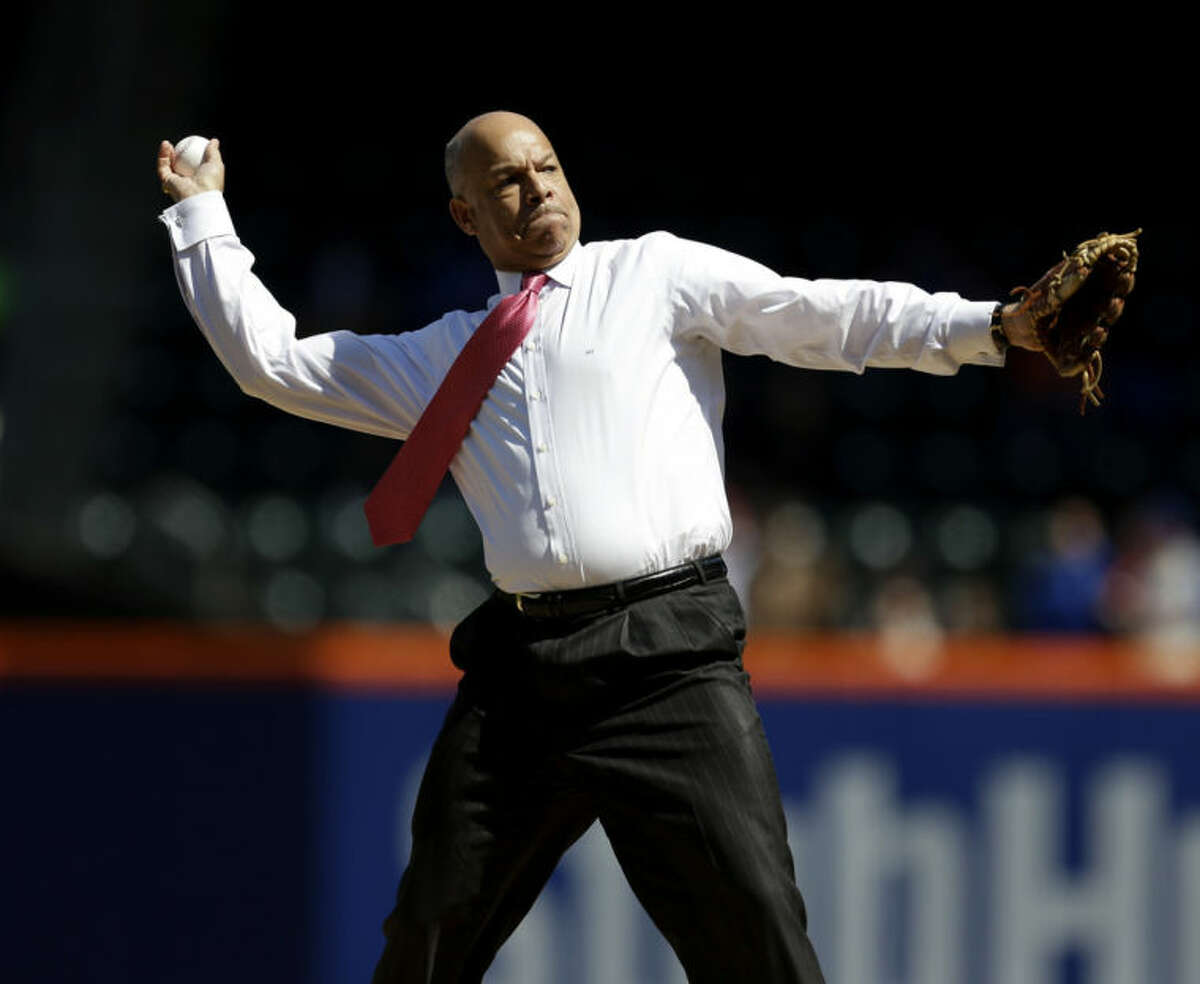 Secretary of Homeland Security Jeh Johnson throws out the first pitch before the start of baseball game between the New York Mets and the Washington Nationals at Citi Field, Thursday, April 3, 2014 in New York. (AP Photo/Seth Wenig)