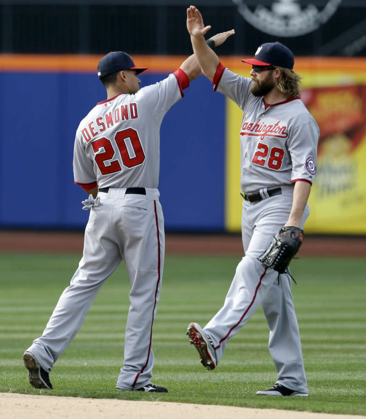 Washington Nationals' Jayson Werth, right, and Ian Desmond celebrate after the baseball game against the New York Mets at Citi Field, Thursday, April 3, 2014, in New York. The Nationals won 8-2. (AP Photo/Seth Wenig)