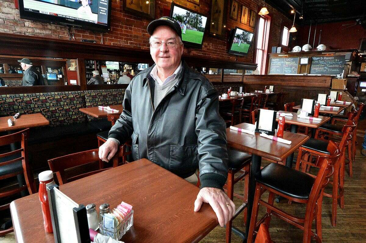 Hour Photo/Alex von Kleydorff Jim Donohue stands inside Donovan's in South Norwalk