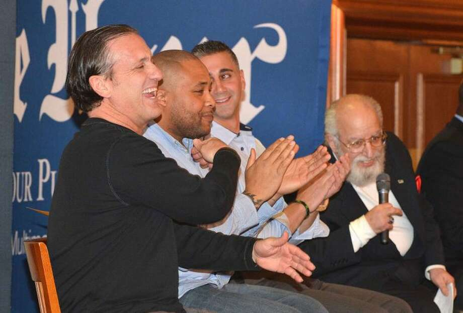 Hour Photo/Alex von Kleydorff Mickey Kydes, Idris Price and Pete Tucci Jr. share a laugh with George Albano and other sports legends on the panel of Sports Talk, A Gentleman's Night Out at The Norwalk Inn and Conference Center