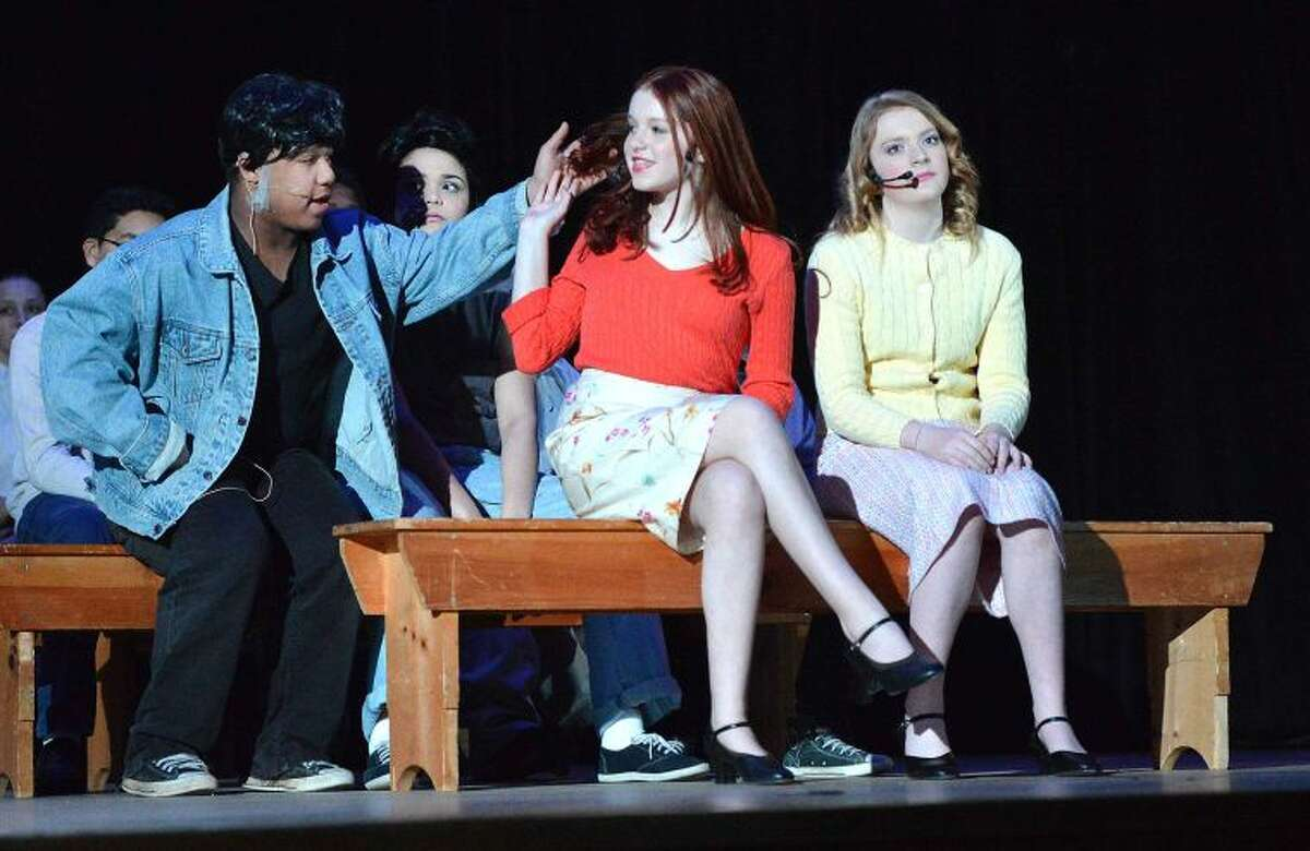 Hour Photo/Alex von Kleydorff Harold Gogarty as Dallas watches a movie with Julia Forschino as Cherry and Riley Finn as Marcia in Ponus Ridge Middle School production of The Outsiders
