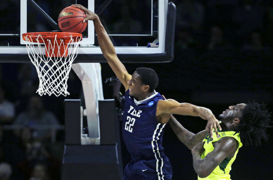 Yale forward Justin Sears (22) slams a dunk as he gets past Baylor forward Taurean Prince (21) in the second half during the first round of the NCAA college men's basketball tournament in Providence, R.I., Thursday, March 17, 2016. (AP Photo/Charles Krupa)