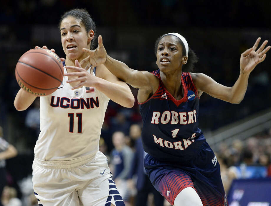 Connecticut's Kia Nurse, left, steals the ball from Robert Morris' Jocelynne Jones, right, during a first round women's college basketball game in the NCAA Tournament, Saturday, March 19, 2016, in Storrs, Conn. (AP Photo/Jessica Hill)
