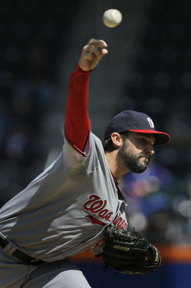 Washington Nationals pitcher Tanner Roark throws during the first inning of a baseball game against the New York Mets at Citi Field, Thursday, April 3, 2014, in New York. (AP Photo/Seth Wenig)