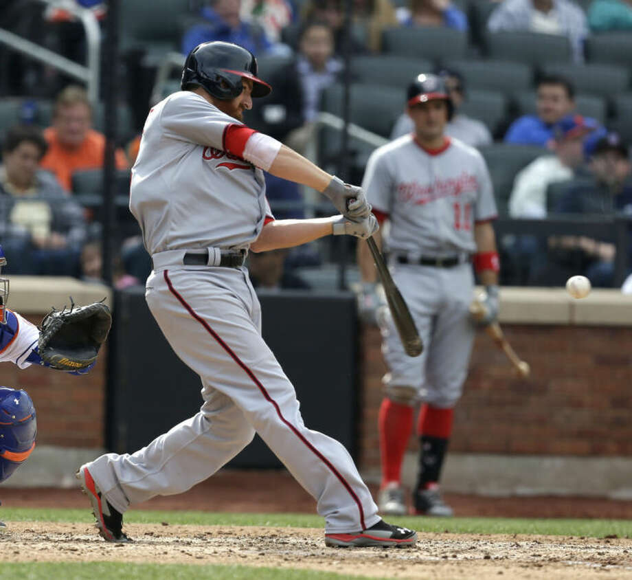 Washington Nationals' Adam LaRoche hits a two-run RBI single during the seventh inning of the baseball game against the New York Mets at Citi Field, Thursday, April 3, 2014 in New York. (AP Photo/Seth Wenig)